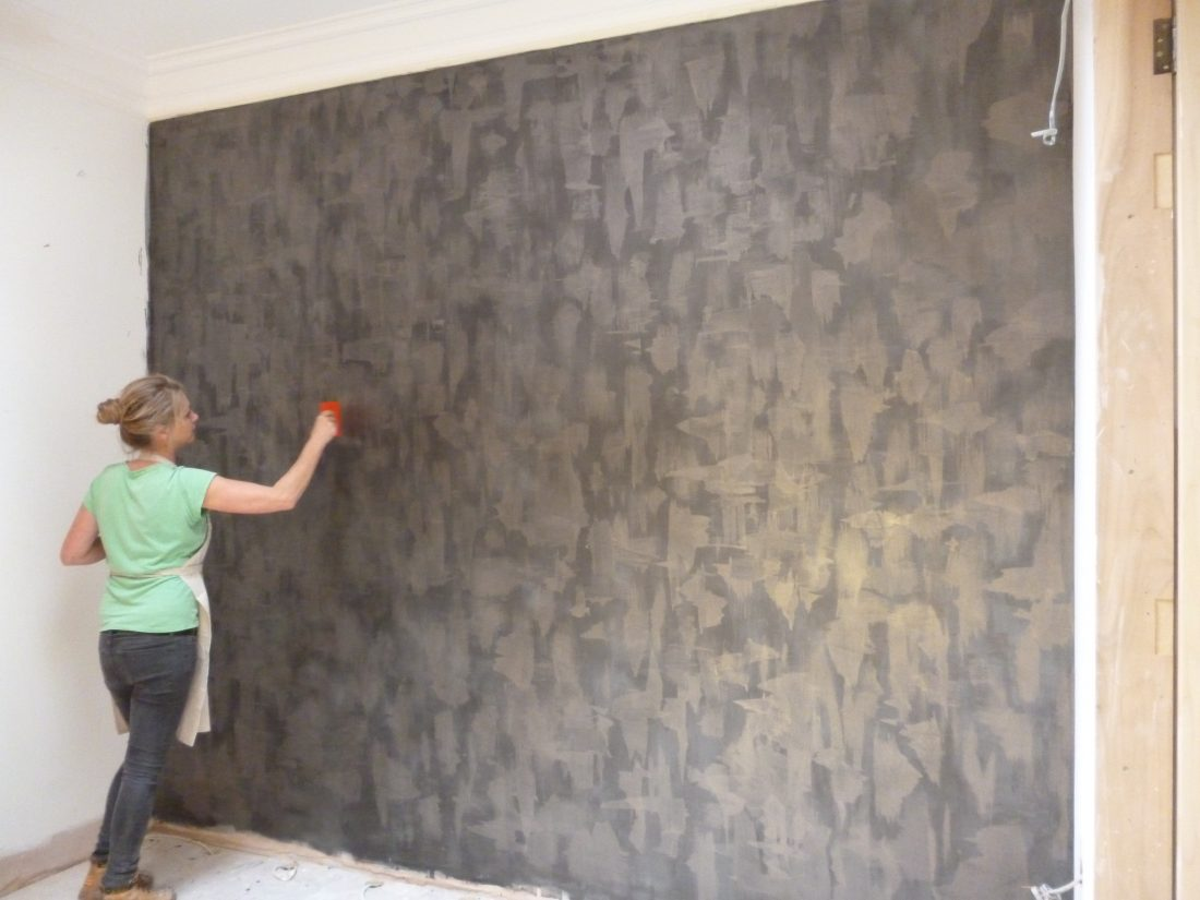 Specialist decorator painting dark gold feature wall, Chelsea