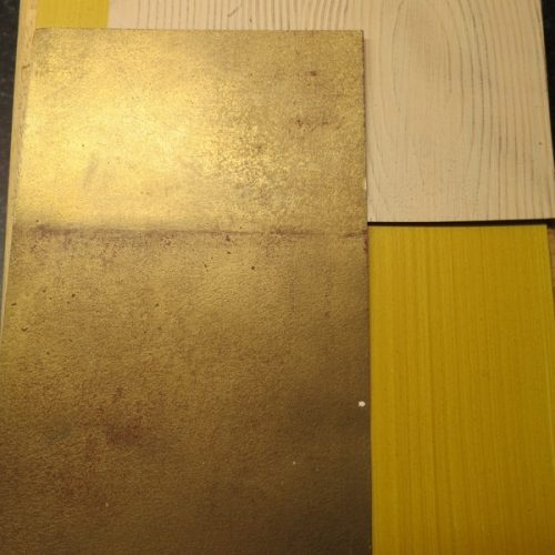 Samples Of Burnished Gold Leaf, Amber Drag, And Raised Wood Graining Effect